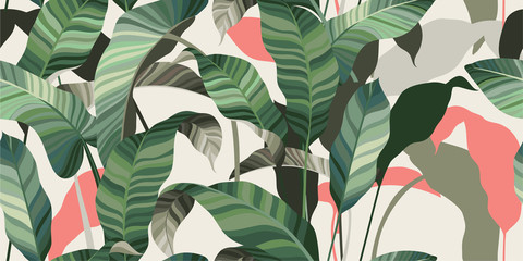Summer seamless pattern. Green and pink leaves of palm trees and tropical plants on a light background. Vector illustration