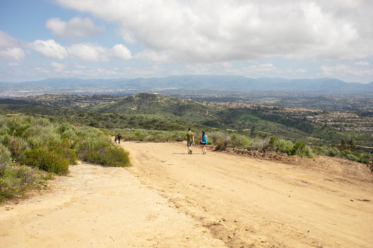 People hiking at Aliso & Woods Canyon Wilderness trail in the spring after a rainy season, Laguna Beach, CA hiking trails.