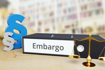 Embargo – Gesetz/Recht. Ordner auf Schreibtisch mit Beschriftung neben Paragraf und Waage. Anwalt Wall mural
