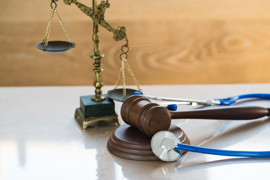 Law and Justice concept. Gavel and stethoscope