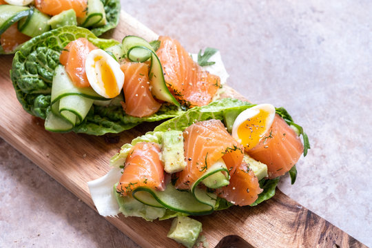 Lettuce wrapped smoked salmon tacos with fresh cucumber, avocado and quail eggs