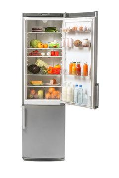 Open fridge full of food on white background
