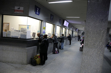 People buy train tickets in Sofia Central railway station