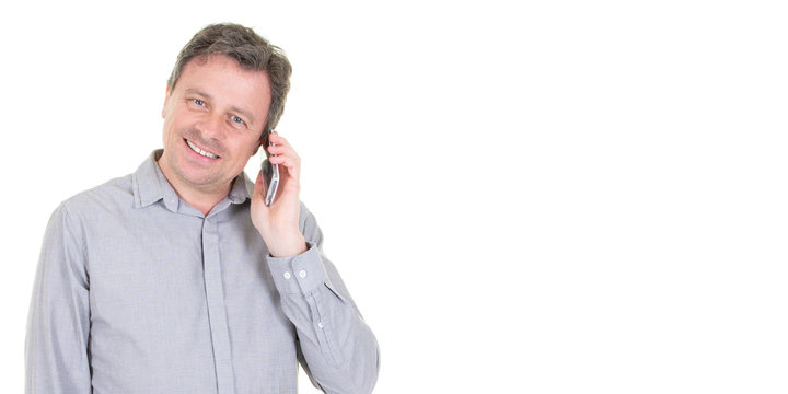 Happy middle aged businessman talking on cell phone in white template web background copy space
