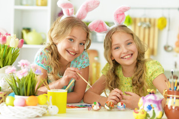Portrait of sisters preparing for Easter in the kitchen