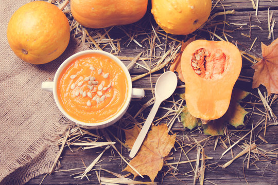 pumpkin soup on a wooden background