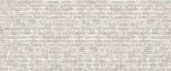 Beige brick wall seamless pattern.