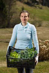 Woman gardener showing seedlings collection prepared to be planted on garden.
