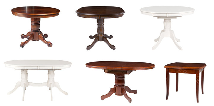 Set of different wooden tables isolated on white.