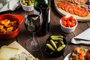 Glass of wine on a table with tapas dishes