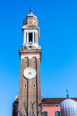 Italy, Venice, ancient tower in a town square.