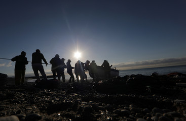 Fishermen drag their boat during the traditional Poutine fishing in Cagnes-Sur-Mer