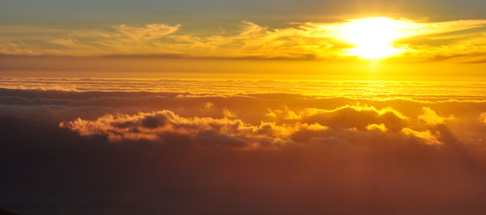 Golden sunset above clouds, mountain view, Table Mountain, South Africa