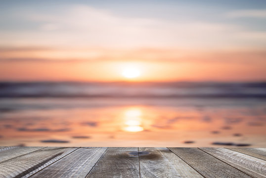 Empty wooden table and beautiful ocean with sunset.