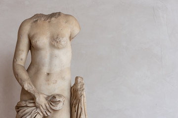 Ancient roman statue in ruins showing a nude female body