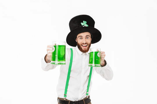 Cheerful young man celebrating St.Patrick 's Day
