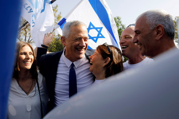 Benny Gantz, leader of Blue and White party, celebrates with supporters and his wife Revital after casting his ballot as Israelis began voting in a parliamentary election, near a polling station in Rosh Ha'ayin, Israel