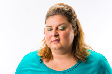 Close-up of fat annoyed woman