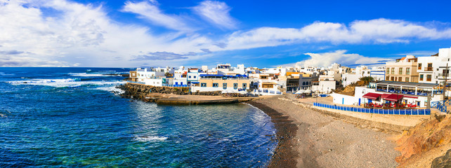Fototapete - Scenic colorful traditional village El Cotillo with great beach. Fuerteventura. Canary islands