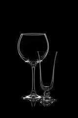 Glassware silhouettes on black.