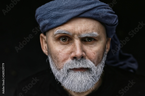 make-up man with a beard / concept oriental portrait in traditional