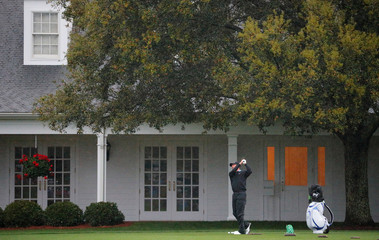 Jose Maria Olazabal of Spain hits balls in the rain while on the driving range during the second day of practice for the 2019 Masters golf tournament at the Augusta National Golf Club in Augusta, Georgia, U.S.