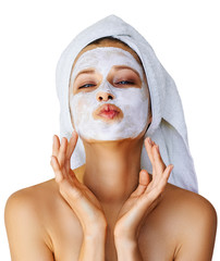 Fototapeta Beautiful young woman with facial mask on her face. Skin care and treatment, spa, natural beauty and cosmetology concept, isolated over white background obraz