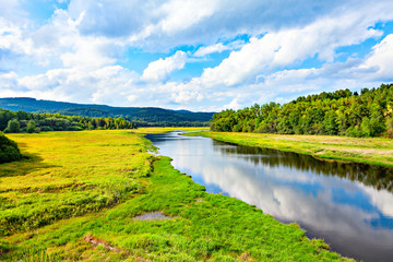 Beautiful natural river landscape with forest and hills. Fototapete