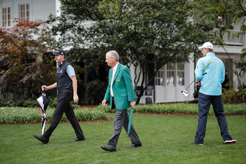 Justin Rose of England walks after play was suspended due to weather during the second day of practice for the 2019 Masters golf tournament at the Augusta National Golf Club in Augusta, Georgia, U.S.