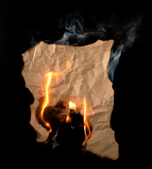 .burning piece of crumpled paper
