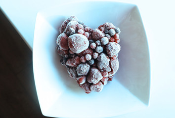 """""""Look after your heart"""". Heart shaped frozen berries straight from the freezer"""