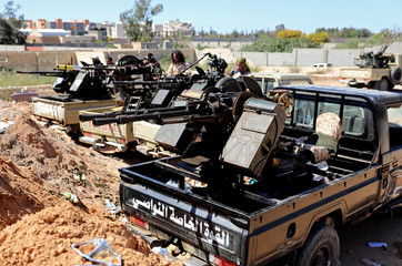 Military vehicles of Misrata forces, under the protection of Tripoli's forces, are seen near a military camp in Tripoli