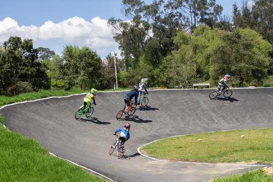 people riding bikes in park