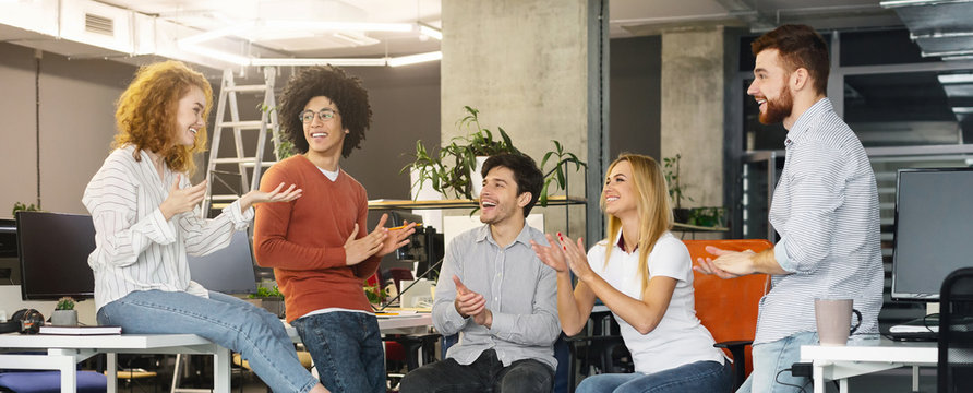 Group multiethnic business people applauding to new member of team