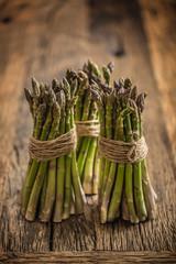 Fresh green asparagus on old oak table