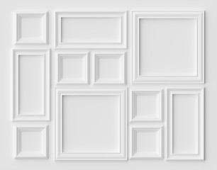 White picture or photo frames on the white wall with shadows