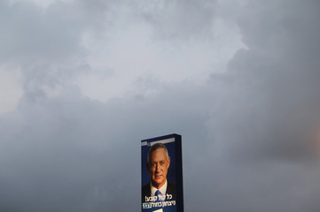An election campaign billboard depicting Benny Gantz, leader of Blue and White party, is seen against the sky in Tel Aviv, Israel