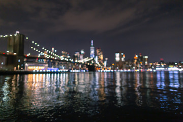 Blurred  Financial District at night from East River