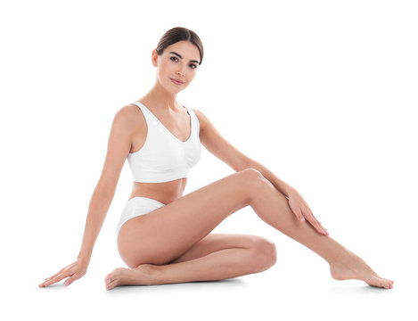 Young woman with perfect skin on white background. Beauty and body care