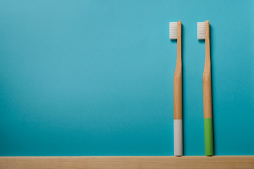 white and green colours bamboo toothbrushes on blue background. Place for text. Ecoproduct.   eco-friendly Wall mural