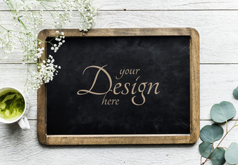 Vintage Framed Chalkboard on White Wooden Surface Mockup