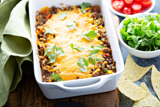 Traditional mexican meat casserole with cheese and vegetables