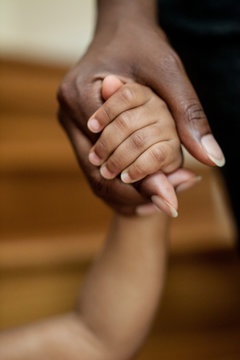 Close up of mother holding daughter's hand