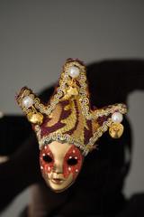 miniature Carnival mask on black