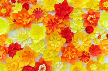 Decorative flowers made from craft paper on white background. Handwork. Spring Holiday Postcard.