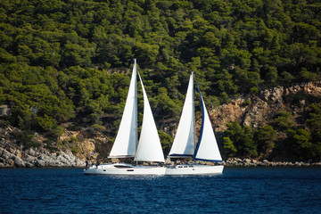 Wall Mural - Sailing luxury boats participate in sail yacht regatta in the Aegean Sea - Greece.