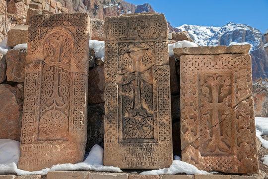 Khachkars (cross-stones) of the Noravank Monastery. Armenia. (non-English text : old Armenian language, prayers, religious texts)
