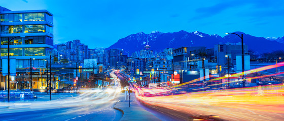 Fotomurales - light trails go out of the downtown vancouver
