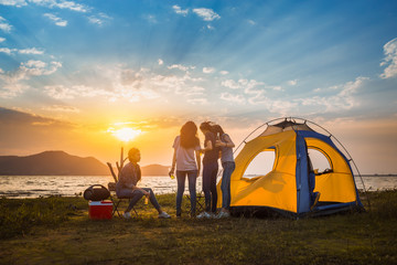 Group of asian women party with drink bottles enjoy travel camping,trekking in vacation time at sunset. Fototapete