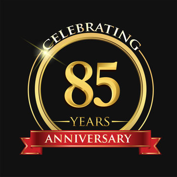 Celebrating 85 years anniversary logo. with golden ring and red ribbon.